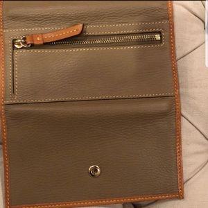 Dooney Bourke wallet. Tan in color. Like new.